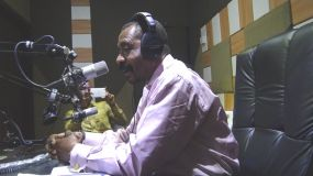 CEO of PEF speaks on a radio station in Ejura.jpg